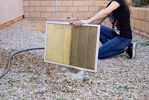 Use a low-pressure water source to clean your filter